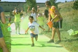 Photo of chid running through chalk
