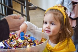 Photo of child picking candy froma bowl