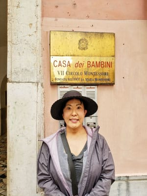 "Photo of Ryoko outside the birthplace of the ""Montessori Method"" in Rome, Italy."
