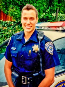 Photo of Terri Wiebold as a police officer