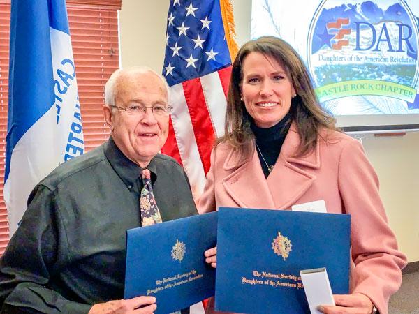 Photo of Joe Gschwendtner and Terri Wiebold being honored by the DAR
