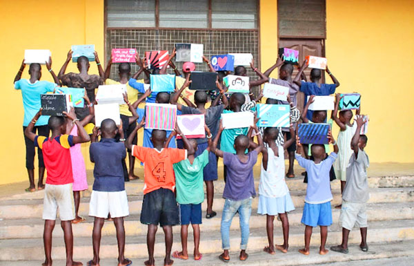 Photo of children of Ghana with their blessing boxes.