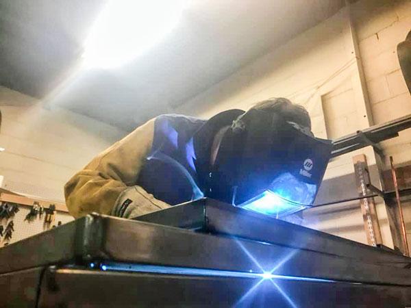 Photo of Harry Abramovitz learning welding