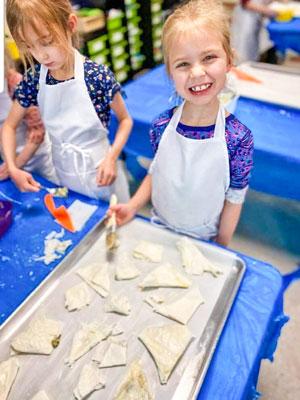 Photo DCSM girls making Albanian feta pies