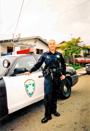 Photo of Shannon Jensen by her patrol car