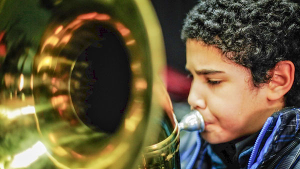 Boy playing Tuba
