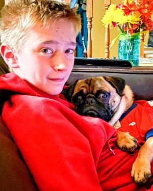 Photo of boy with dog
