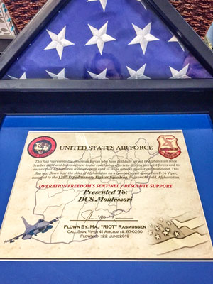 Photo American flag and certificate of Operation Freedom's Sentinel.