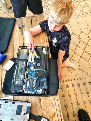 Photo of third grader installing a stick of RAM