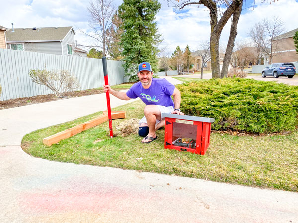 Photo of Michael Dauro installs the new Little Free Library