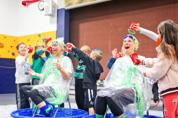 Photo of Never lacking school spirit, Ronda Gutierrez gets slimed at a school assembly after fundraising for the American Heart Association's Jump Rope for Heart.