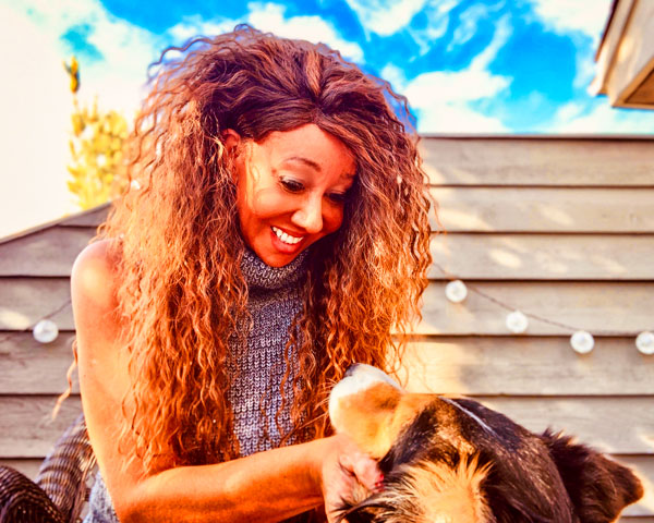 Photo of Marco Fields and her dog, Callie.