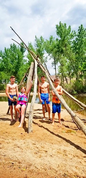 Photo of kids that paddled to sand bar at Chatfield Reservoir