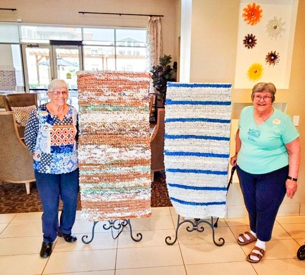 Photo of AJ and Kim from MorningStar Senior Living who make sleeping mats