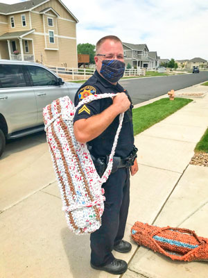 Photo of DCSO Corporal Brian Briggs carries a sleeping mat