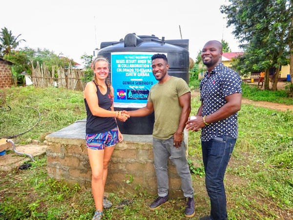 Photo of Carly Markowski with Joshua and Atta, founders of ISHEW Ghana.