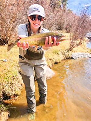 Photo of Rachel Powner holds a fish she caught