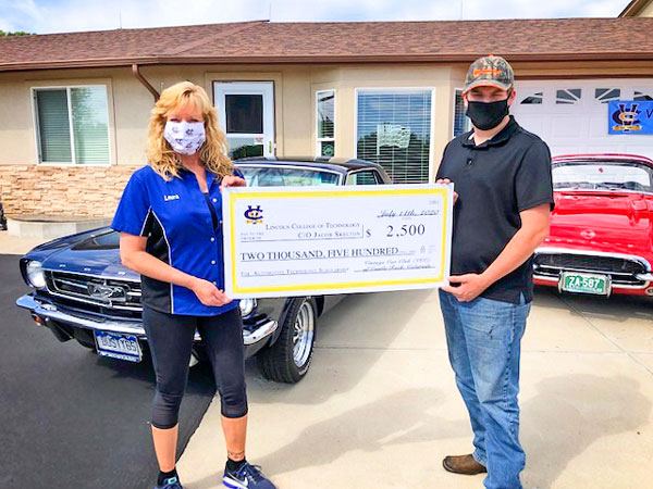 Photo of vintage Car Club of Castle Rock presents scholarship check