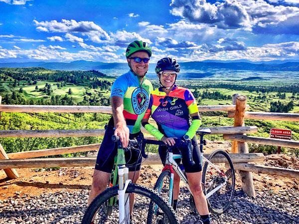 Photo of Michelle Barton and Clint Bickmore biking.