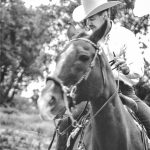 Photo of Dennis Niewoehner on his beloved horse, Wrangle