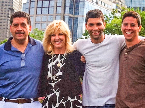 Photo of Lynda Hernandez with her husband, Gilbert, and two sons Thomas and Mark
