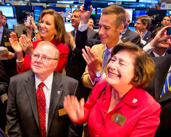 Photo of Liningers at New York Stock Exchange.