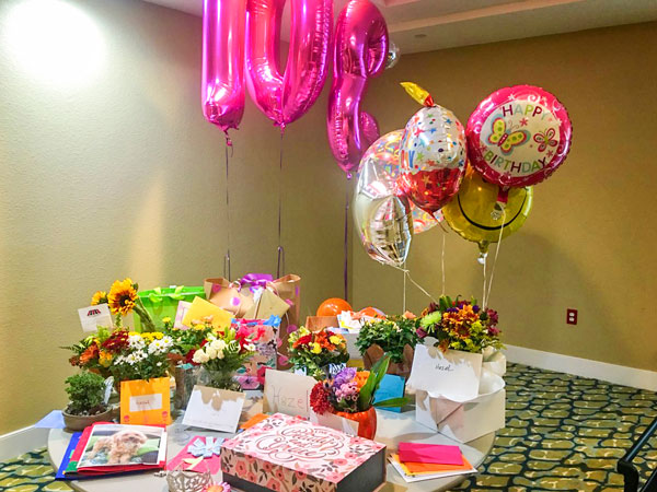 Photo of Hazel Bagley receiving more than 500 cards, dozens of flower arrangements, balloons and gifts to celebrate her birthday