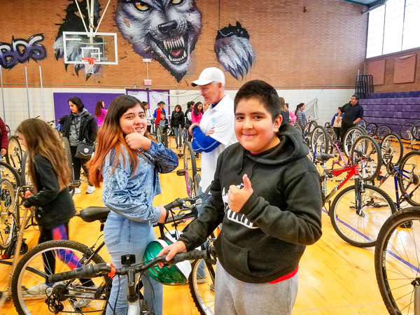 Photo of kids getting bikes from Project Recycle