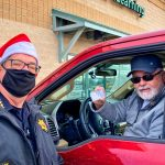 Photo of Sheriff Spurlock hit the drive-thru line donning his Santa hat at Ziggi's