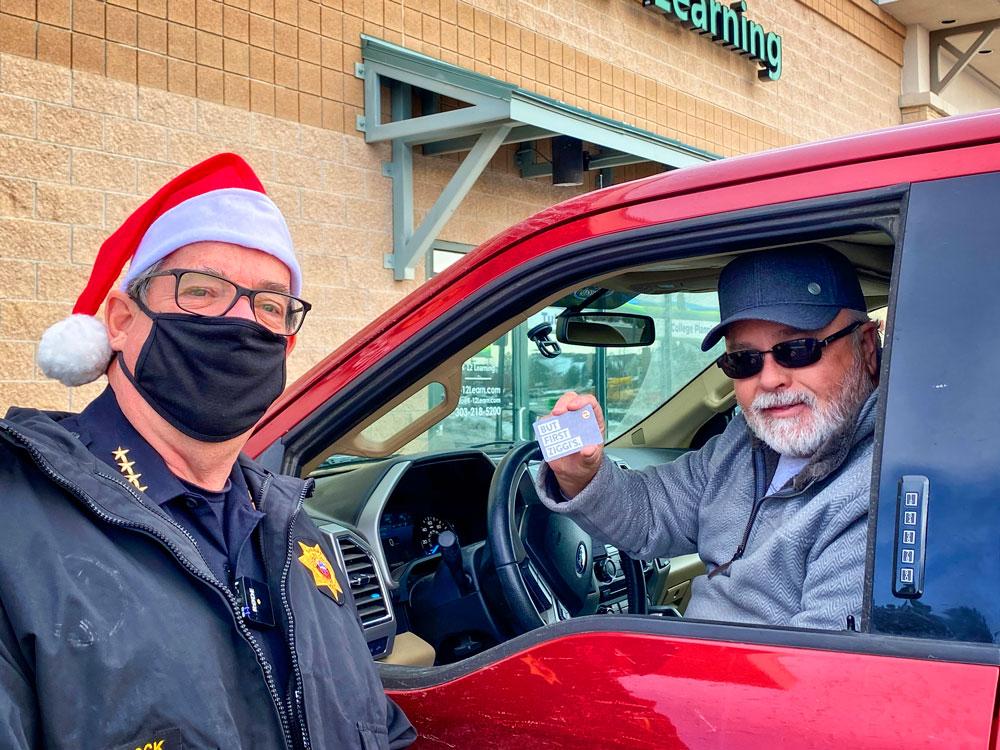 Photo of Sheriff Spurlock hit the drive-thru line donning his Santa hat at Ziggi's