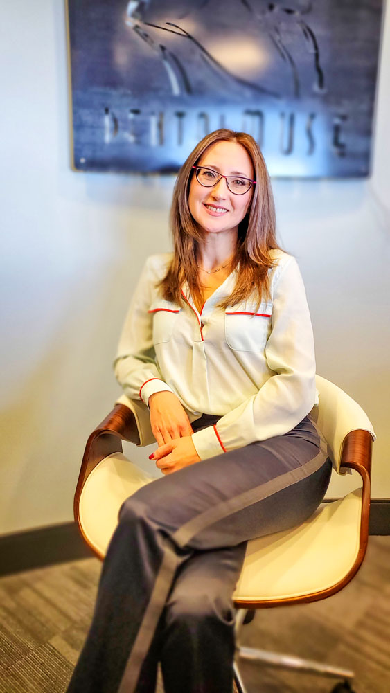 Photo of Dr. Rabinovich at her dental practice in the City of Castle Pines