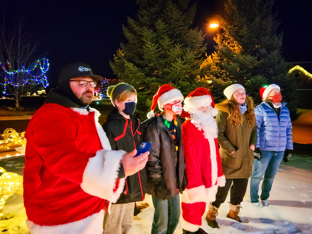 Photo of Students and family members joined the inaugural Douglas County Campus Life Christmas Caroling in the Pines