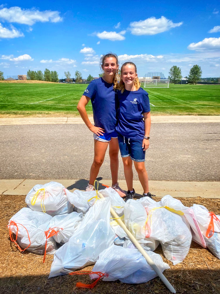 Photo of girls from Elevation Chapter of National Charity League participates in clean-up activities around Douglas County