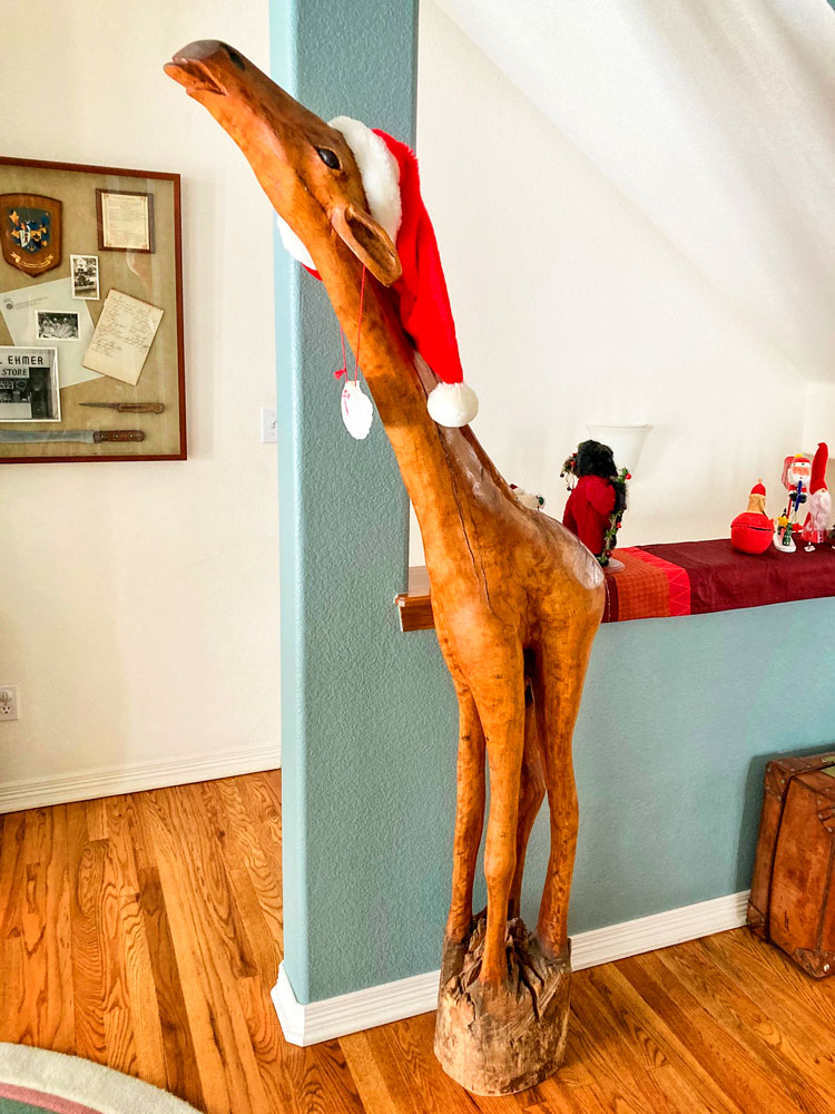 Photo of 6-foot giraffe carved of red swamp cypress.