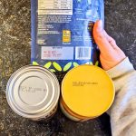 Photo of canned goods howing expiration dates