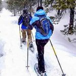 Photo of people snowshoeing