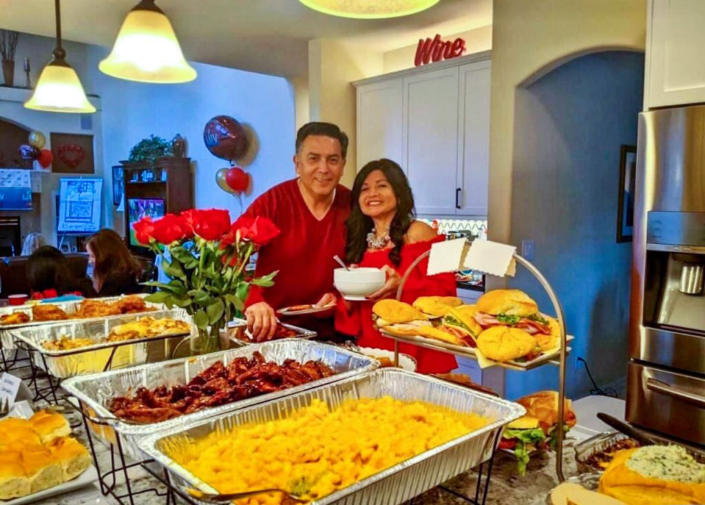 Photo of Xavier and Rina Castanon at one of their Super Bowl parties.