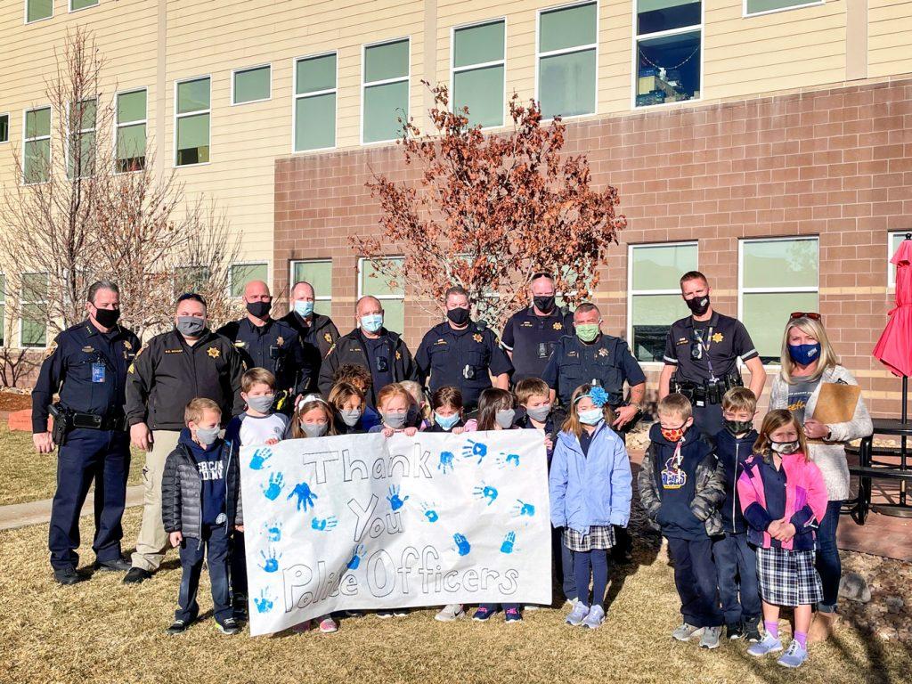 Photo of American Academy kids with Douglas County Sheriff and deputies