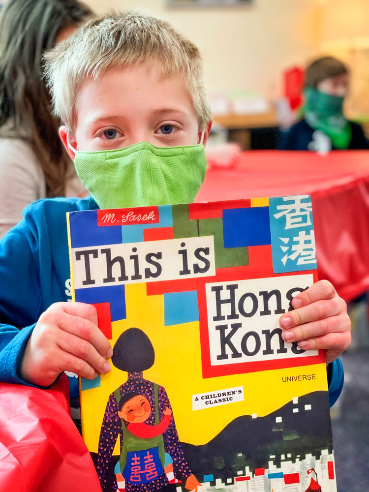 Photo of Student James Hershman reads This is Hong Kong.
