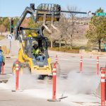 Repairing the persistent potholes that are ever-developing on the road in Castle Pines
