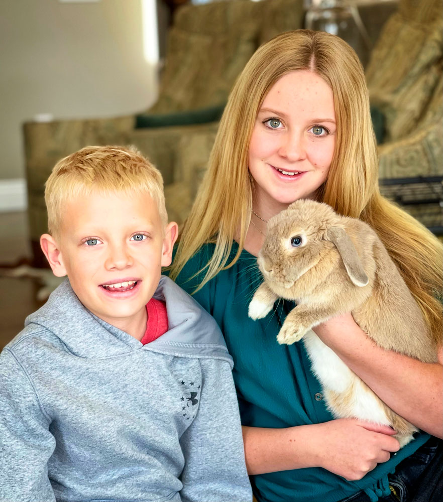Photo of Parker and Katelyn Calfee with their pet bunny