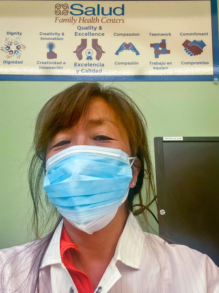 Photo of Hiemi Haines who volunteers at several vaccination clinics that serve low-income