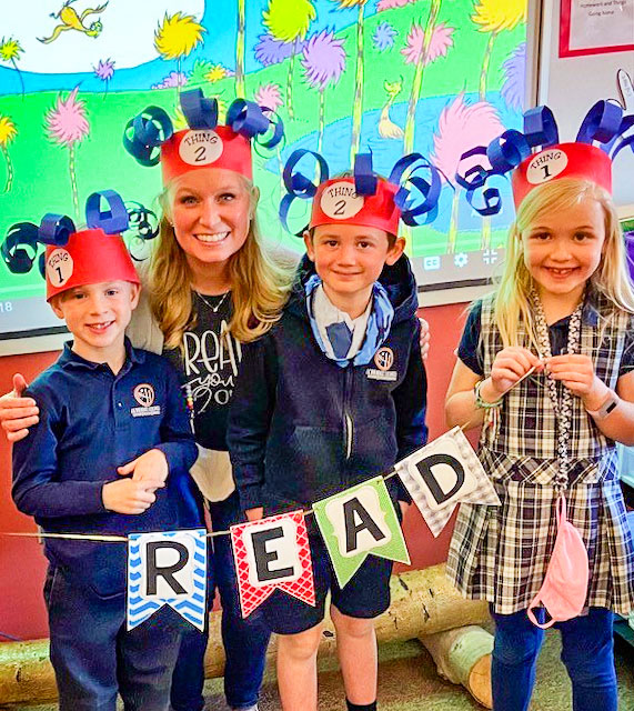 Photo of first grade teacher Erin Dill, students Dylan McNitt (left), Weston Sakosky and Charlotte Rigg (far right)