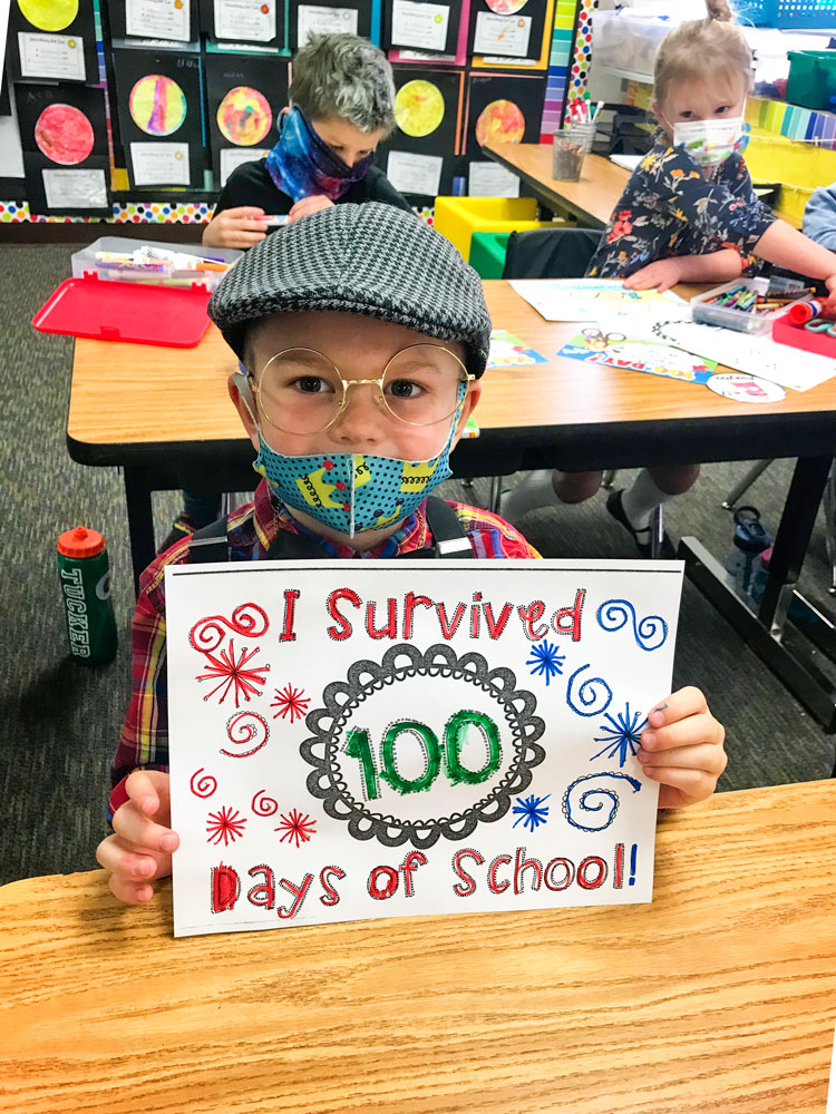 Andre P. boldly declares his survival of the first 100 days of kindergarten