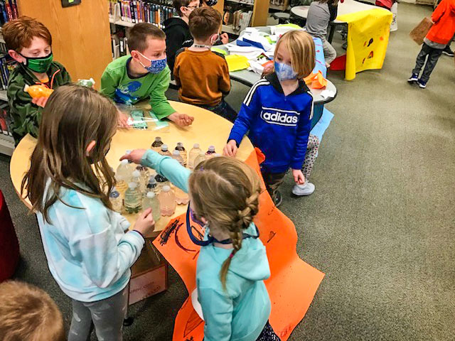 Photo of Student entrepreneurs of Calming Kids business show interested first grade
