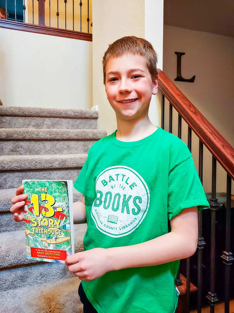fourth grader Matthew Liepen holds one of his favorite reads