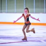 Photo of figure skater Autumn Hall skates at a regional competition