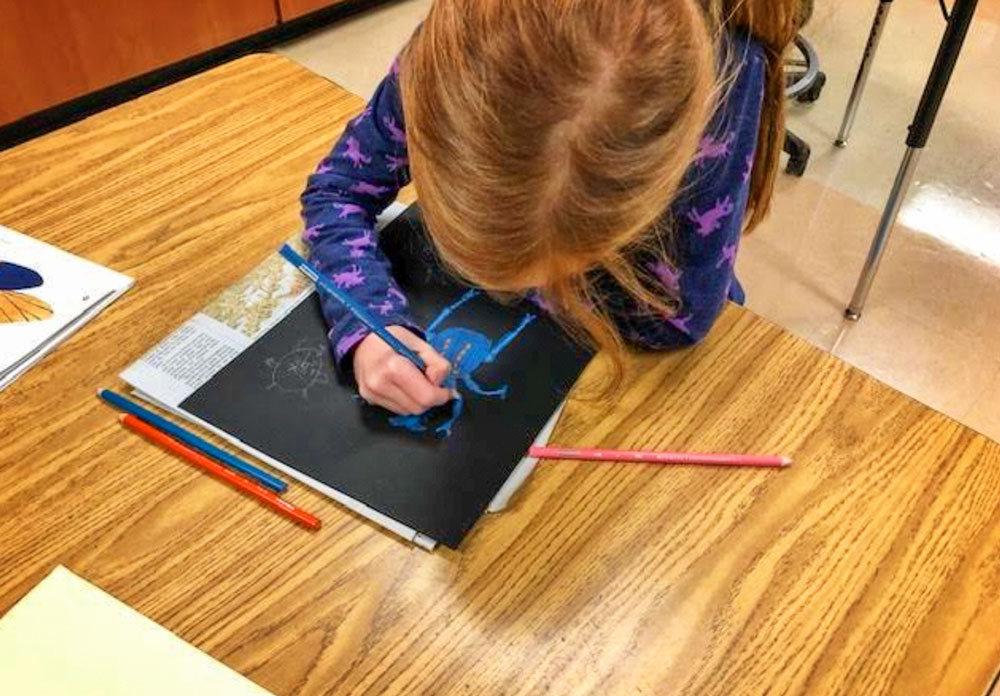 Student drawing digital art