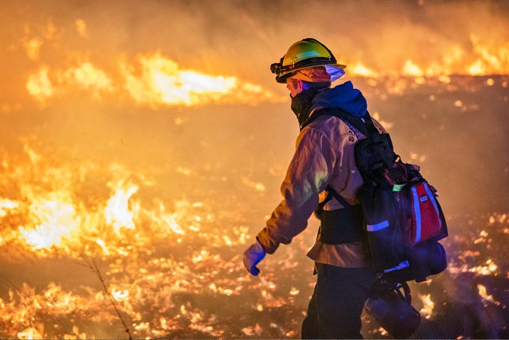 Photo of SMFR crew fighting a wildland fire