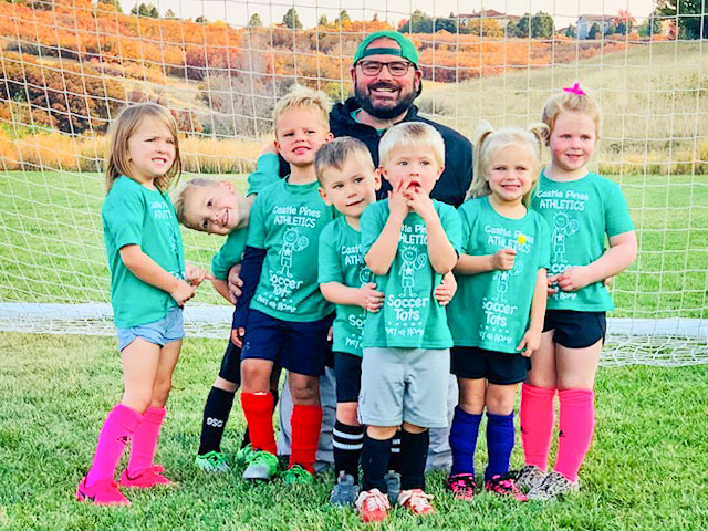 Photo of Volunteer coach Donny McCleery gets silly with the soccer tots.